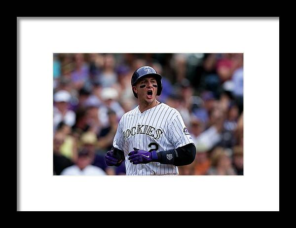 Scoring Framed Print featuring the photograph Carlos Gonzalez and Troy Tulowitzki by Justin Edmonds