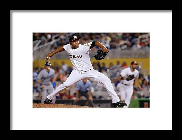 Baseball Pitcher Framed Print featuring the photograph Carlos Marmol by Rob Foldy