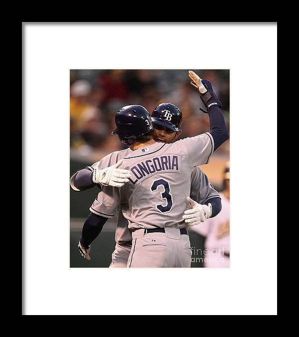 American League Baseball Framed Print featuring the photograph Carlos Pena and Evan Longoria by Jed Jacobsohn