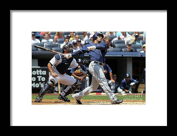 Following Framed Print featuring the photograph Carlos Pena by Jim Mcisaac