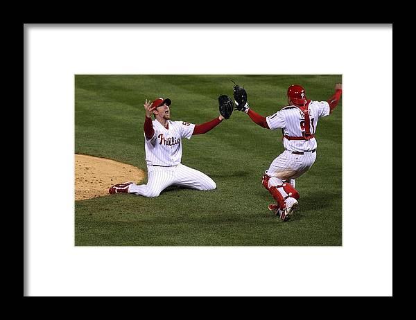 Carlos Ruiz Framed Print featuring the photograph Carlos Ruiz and Brad Lidge by Jim Mcisaac