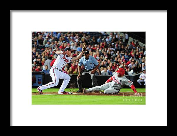Atlanta Framed Print featuring the photograph Carlos Ruiz and Chipper Jones by Scott Cunningham