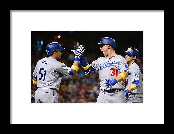 American League Baseball Framed Print featuring the photograph Carlos Ruiz and Joc Pederson by Jennifer Stewart