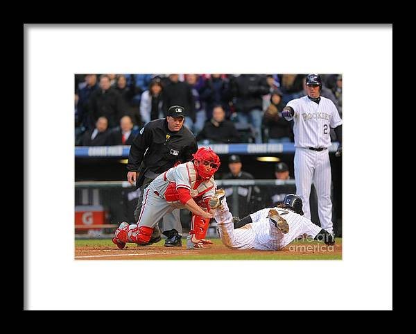Playoffs Framed Print featuring the photograph Carlos Ruiz and Todd Helton by Doug Pensinger