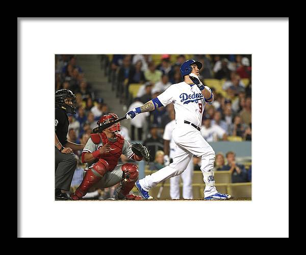 People Framed Print featuring the photograph Carlos Ruiz And Yasmani Grandal by Harry How