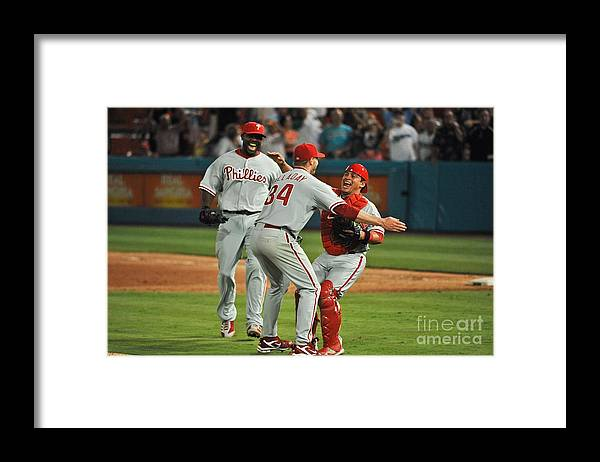 Carlos Ruiz Framed Print featuring the photograph Carlos Ruiz, Ryan Howard, and Roy Halladay by Ronald C. Modra