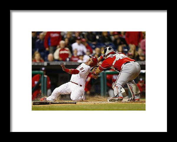 Baseball Catcher Framed Print featuring the photograph Carlos Ruiz, Wilson Ramos, and Odubel Herrera by Rich Schultz