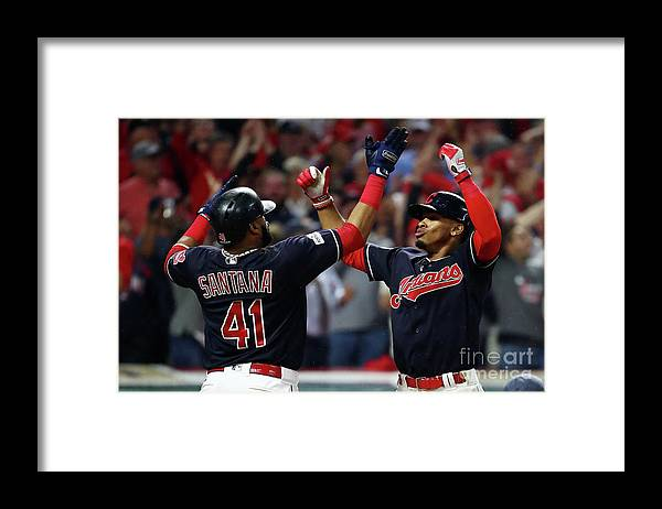 Game Two Framed Print featuring the photograph Carlos Santana and Francisco Lindor by Gregory Shamus