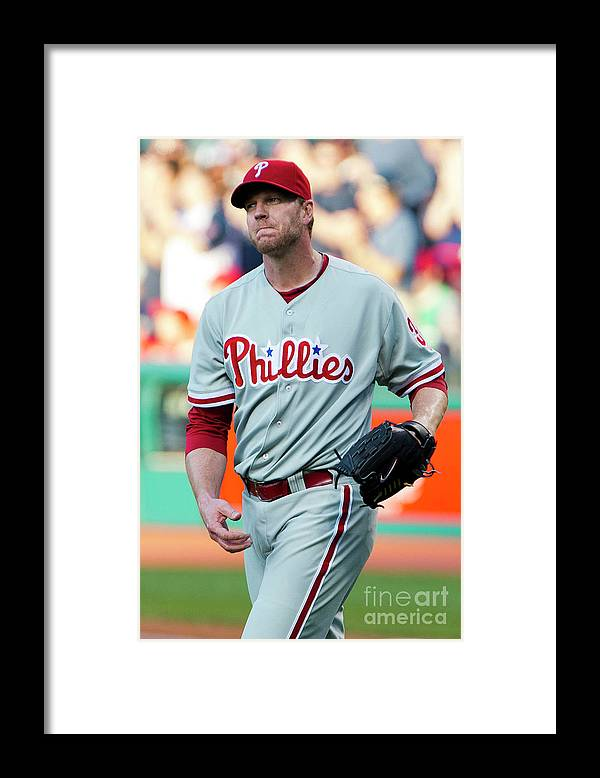 People Framed Print featuring the photograph Carlos Santana and Roy Halladay by Jason Miller