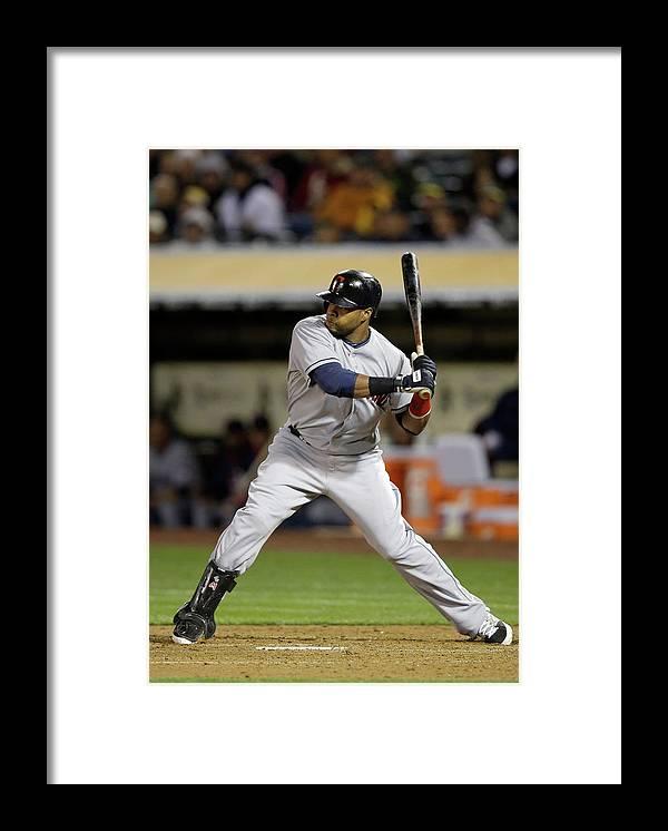 American League Baseball Framed Print featuring the photograph Carlos Santana by Ezra Shaw