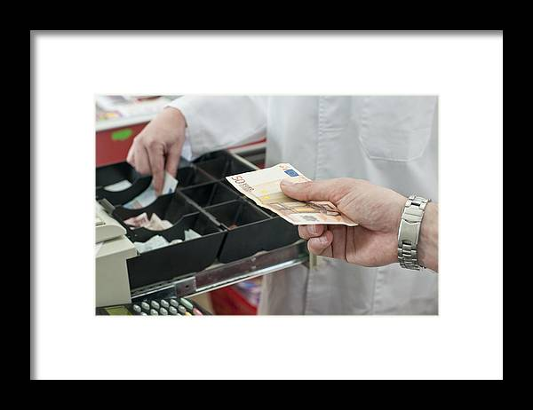 Young Men Framed Print featuring the photograph Cash In Hand Of Customer Paying In Supermarket by Chris Sattlberger