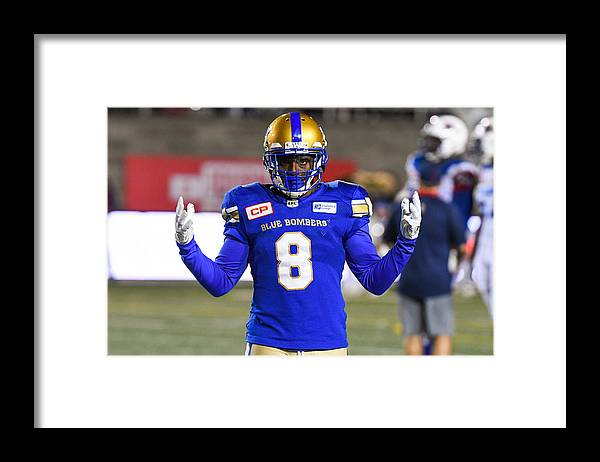 Professional Sport Framed Print featuring the photograph CFL: AUG 24 Winnipeg Blue Bombers at Montreal Alouettes by Icon Sportswire