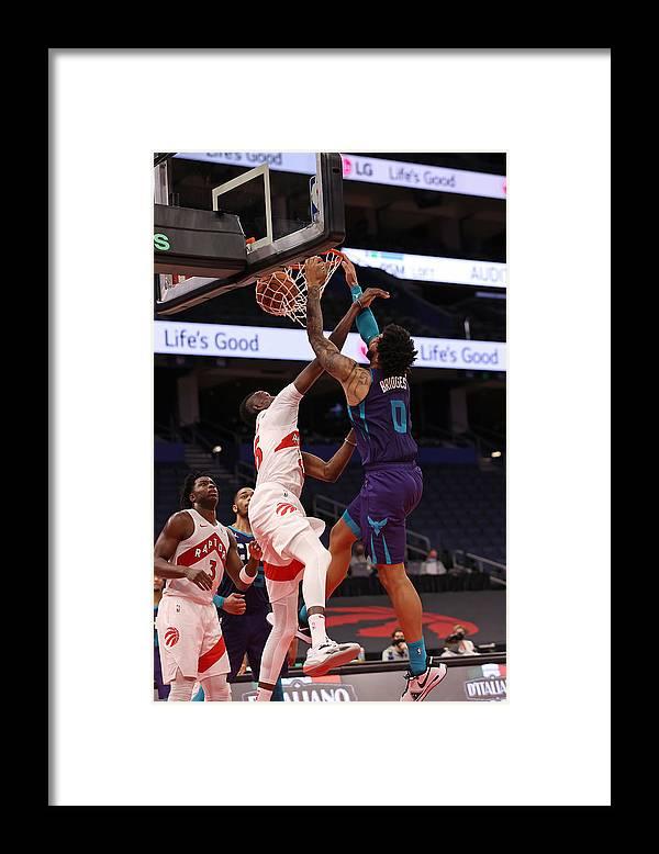 Nba Pro Basketball Framed Print featuring the photograph Charlotte Hornets v Toronto Raptors by NBA Photos