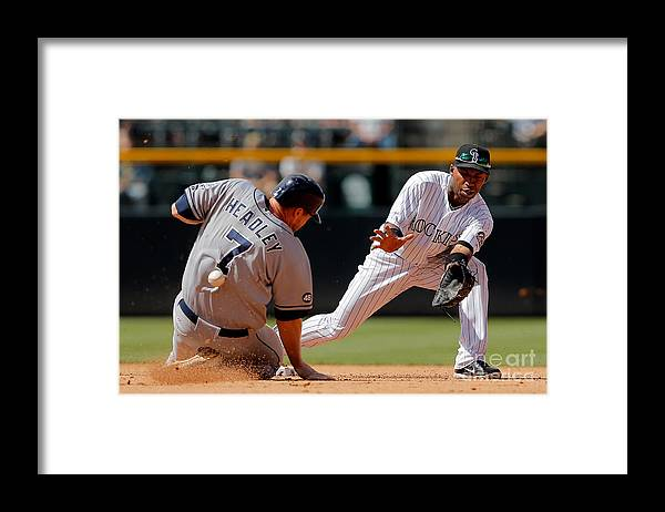 Sports Ball Framed Print featuring the photograph Chase Headley and Jonathan Herrera by Doug Pensinger