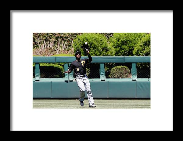 People Framed Print featuring the photograph Chase Utley and Starling Marte by Brian Garfinkel