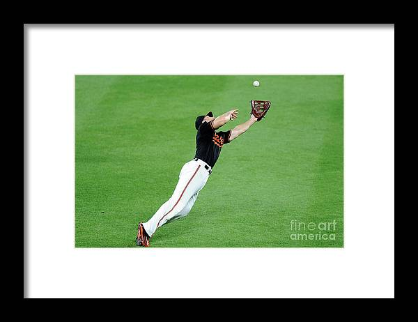 People Framed Print featuring the photograph Chris Davis and Carlos Beltran by Greg Fiume