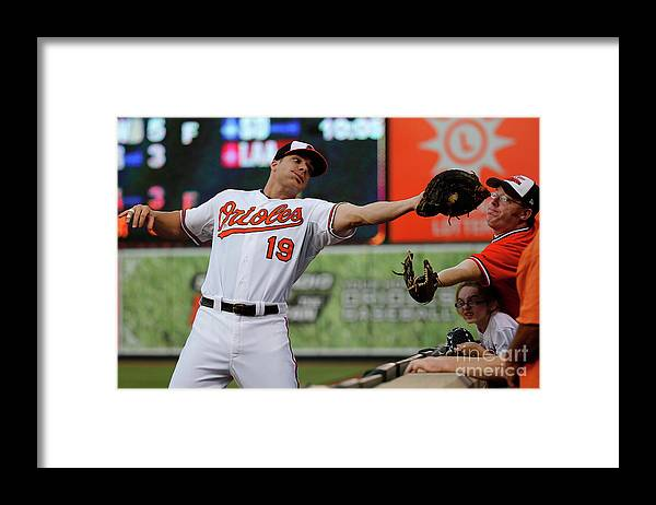 People Framed Print featuring the photograph Chris Davis and Chris Carter by Rob Carr