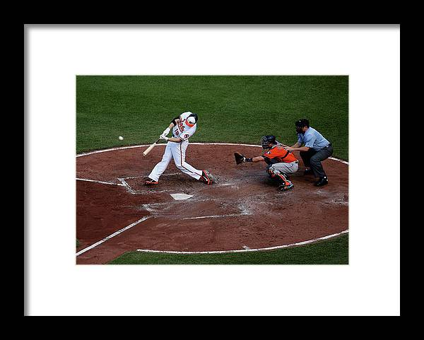 Baseball Catcher Framed Print featuring the photograph Chris Davis and Jason Castro by Rob Carr