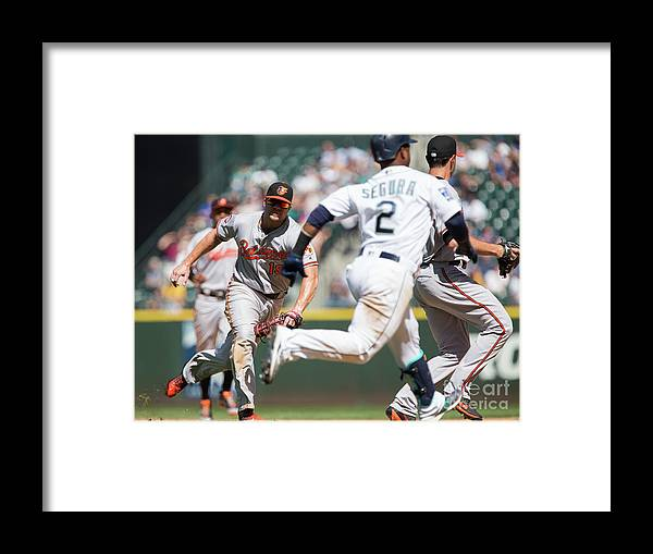 People Framed Print featuring the photograph Chris Davis and Jean Segura by Lindsey Wasson