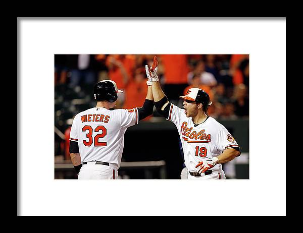 American League Baseball Framed Print featuring the photograph Chris Davis and Matt Wieters by Rob Carr