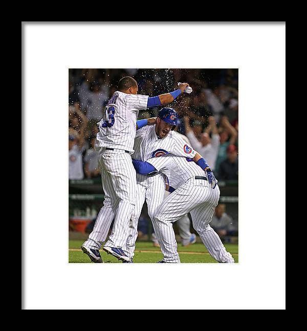 People Framed Print featuring the photograph Chris Denorfia, Anthony Rizzo, and Starlin Castro by Jonathan Daniel