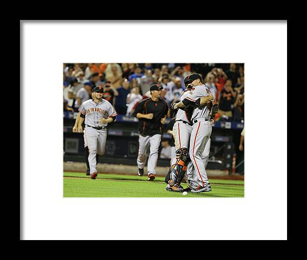 People Framed Print featuring the photograph Chris Heston and Buster Posey by Al Bello