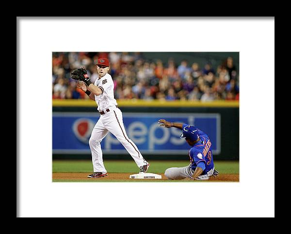 People Framed Print featuring the photograph Chris Owings and Curtis Granderson by Christian Petersen