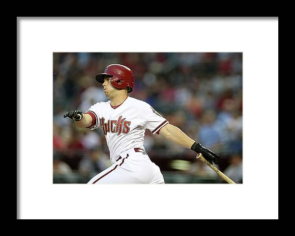 Second Inning Framed Print featuring the photograph Chris Owings by Christian Petersen