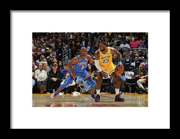 Nba Pro Basketball Framed Print featuring the photograph Chris Paul and Lebron James by Andrew D. Bernstein