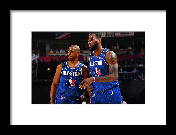 Nba Pro Basketball Framed Print featuring the photograph Chris Paul and Lebron James by Jesse D. Garrabrant