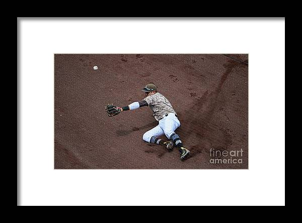 Second Inning Framed Print featuring the photograph Christian Villanueva and Brandon Belt by Denis Poroy