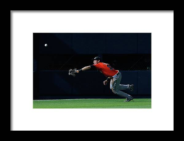 Atlanta Framed Print featuring the photograph Christian Yelich and Jordan Schafer by Kevin C. Cox
