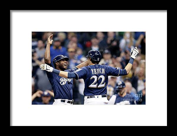 People Framed Print featuring the photograph Christian Yelich and Lorenzo Cain by Dylan Buell