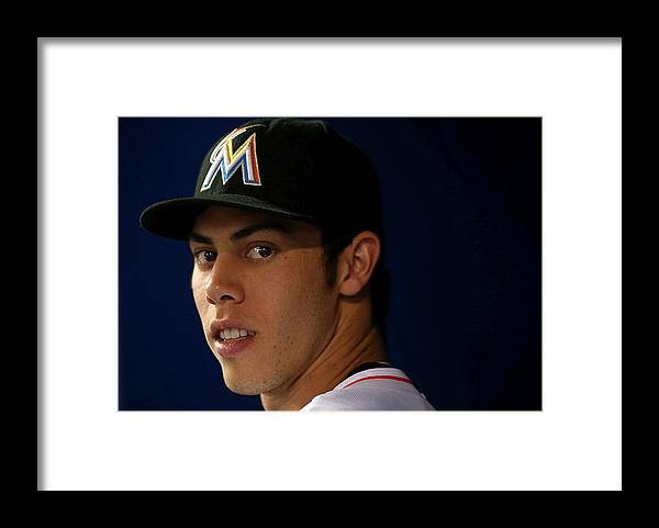 American League Baseball Framed Print featuring the photograph Christian Yelich by Mike Ehrmann