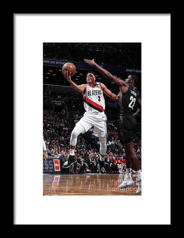 Nba Pro Basketball Framed Print featuring the photograph C.j. Mccollum and Caris Levert by Nathaniel S. Butler