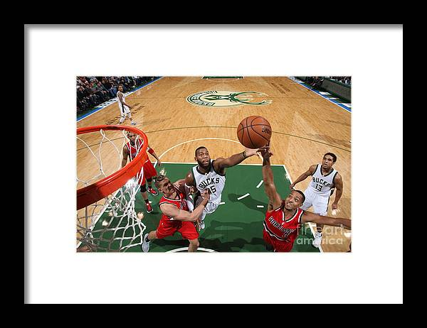 Nba Pro Basketball Framed Print featuring the photograph C.j. Mccollum and Greg Monroe by Gary Dineen