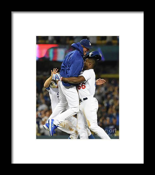 Ninth Inning Framed Print featuring the photograph Clayton Kershaw and Yasiel Puig by Jayne Kamin-oncea