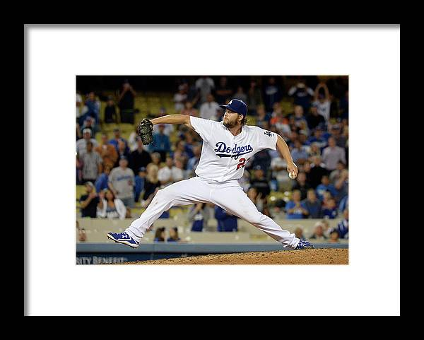 Clayton Kershaw Framed Print featuring the photograph Clayton Kershaw by Kevork Djansezian