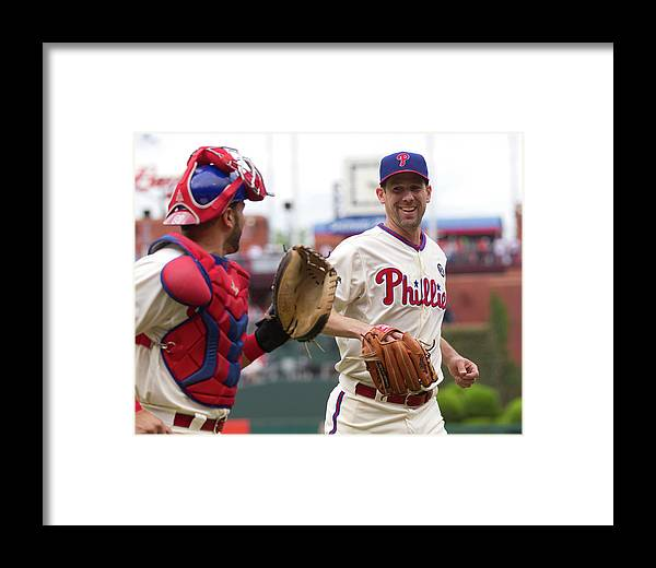 Baseball Catcher Framed Print featuring the photograph Cliff Lee And Wil Nieves by Mitchell Leff