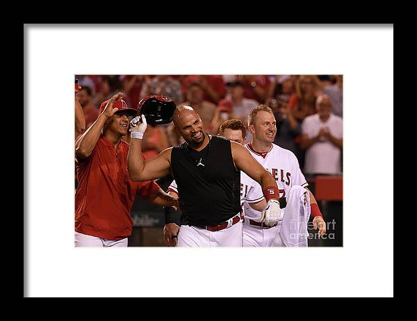 Three Quarter Length Framed Print featuring the photograph Cliff Pennington and Albert Pujols by Lisa Blumenfeld