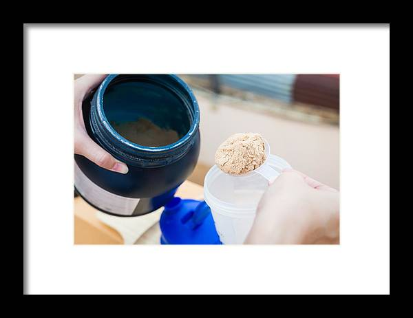 People Framed Print featuring the photograph Close-Up Of Hand Pouring Grounded Food In Container by Chakrapong Worathat / EyeEm
