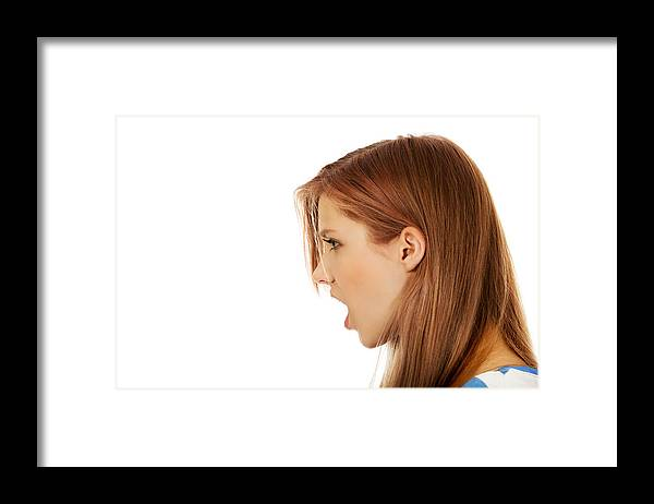 People Framed Print featuring the photograph Close-Up Of Woman With Open Mouth Against White Background by Piotr Marcinski / EyeEm