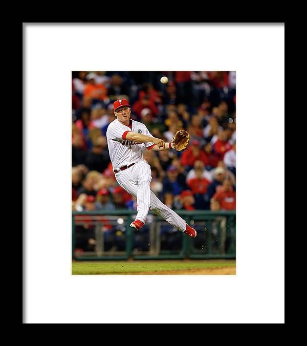 Ball Framed Print featuring the photograph Cody Asche and Tucker Barnhart by Rich Schultz