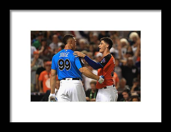 Three Quarter Length Framed Print featuring the photograph Cody Bellinger and Aaron Judge by Mike Ehrmann