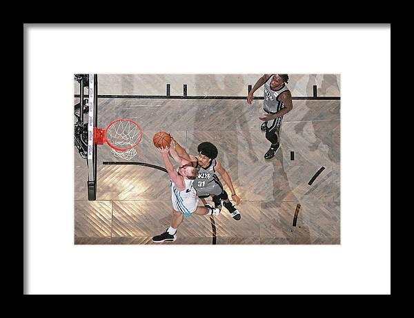 Nba Pro Basketball Framed Print featuring the photograph Cody Zeller and Jarrett Allen by Nathaniel S. Butler