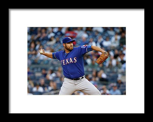 Three Quarter Length Framed Print featuring the photograph Colby Lewis by Al Bello