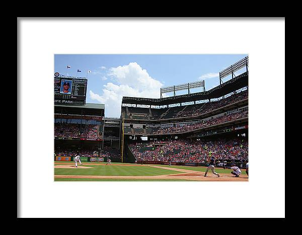 Second Inning Framed Print featuring the photograph Colby Lewis And Trevor Plouffe by Ronald Martinez