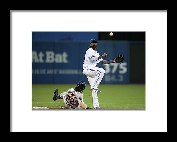 Double Play Framed Print featuring the photograph Colby Rasmus and Jose Reyes by Tom Szczerbowski