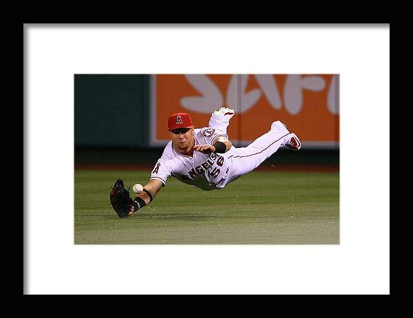 Ninth Inning Framed Print featuring the photograph Colby Rasmus and Kole Calhoun by Victor Decolongon