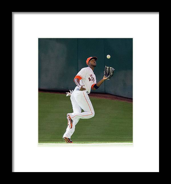 American League Baseball Framed Print featuring the photograph Cole Gillespie and Dexter Fowler by Bob Levey